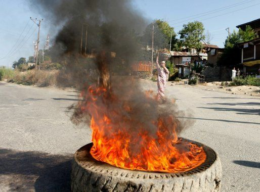 SRINAGAR, INDIA -JULY 9: Protesters burn tyres against the killing of Hizbul Mujahideen commander Burhan...