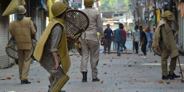 Police clash with Kashmiri protestors in Srinagar on July 11,