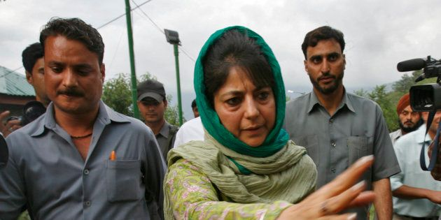 Mehbooba Mufti (C), chief of People's Democratic Party