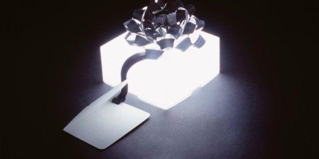 Glowing gift box with ribbon