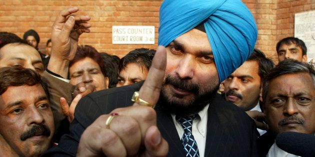 Former Indian cricketer and lawmaker Navjot Singh Sidhu (C) gestures to the media outside a court in...