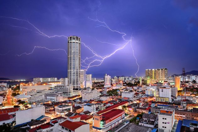 Lightning seemingly strikes Komtar Tower, the most iconic landmark of George Town, capital of Penang...