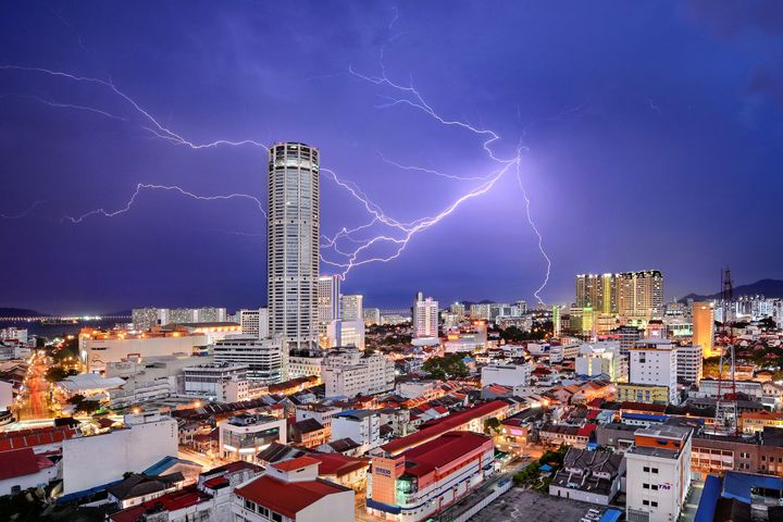 Lightning seemingly strikes Komtar Tower, the most iconic landmark of George Town, capital of Penang state in Malaysia. It is symbolic of the rejuvenation that the city, famous for a unique blend of centuries-old buildings and modern structures, has enjoyed in recent years. While many of its old neighbourhoods fell into neglect in the 1990s and early 2000s, UNESCO World Heritage listing in 2008 sparked a transformation, and today, they are all part of a vibrant tourist destination.