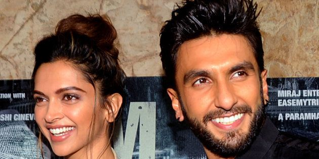 Indian Bollywood actors Deepika Padukone (L) and Ranveer Singh attend a screening of Hindi film 'Madaari'...