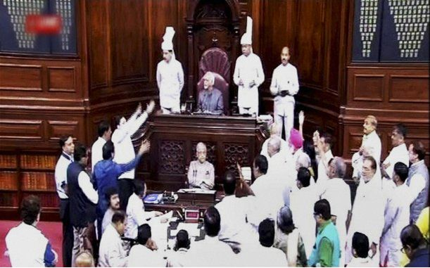 New Delhi: Members raise a protest in the Rajya Sabha during Monsoon session of Parliament in New Delhi...