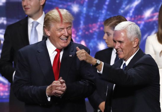 Republican U.S. presidential nominee Donald Trump (L) celebrates with vice presidential nominee Mike...