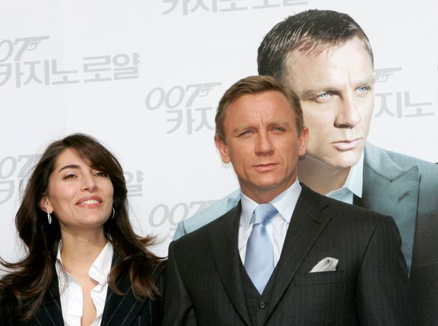 Actors Daniel Craig (R) and Caterina Murino pose for photographers at a photo opportunity before a news...