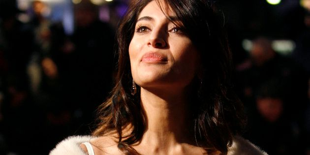 Actress Caterina Murino poses for photographers as she arrives for the world premiere of the James Bond...