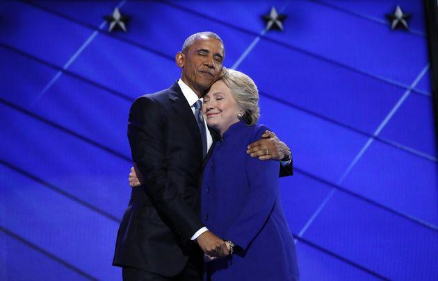 Hillary Clinton hugs U.S. President Barack