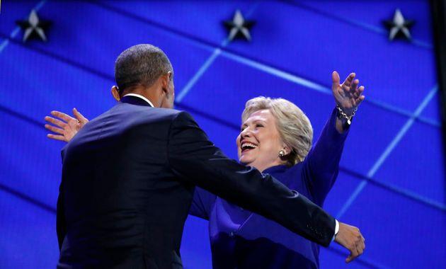 Democratic presidential nominee Hillary Clinton greets U.S. President Barack