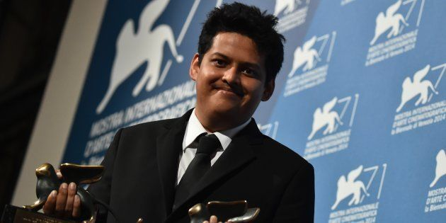 Writer and director Chaitanya Tamhane poses with the Orizzonti Award for Best Film and the Lion of the...
