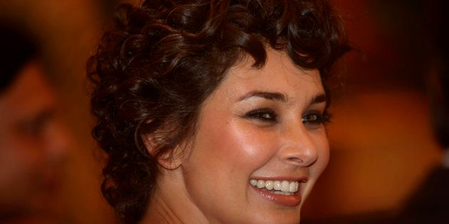 Bollywood actress and model Lisa Ray smiles during the launch of LifeCell Femme Menstrual blood banking service in Mumbai, India, Tuesday, March 8, 2011. LifeCell is the first and only company offering menstrual blood banking to harvest stem cells in India. (AP Photo/Rafiq Maqbool)