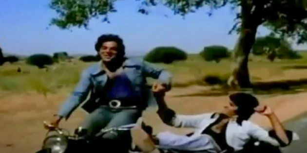 Amitabh Bachchan with Dharmendra in Sholay.