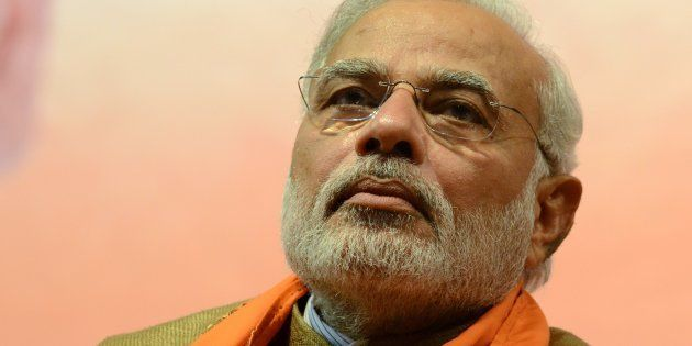 Indian Prime Minister-Elect, Narendra Modi gestures during the announcement of Gujarat's first woman...