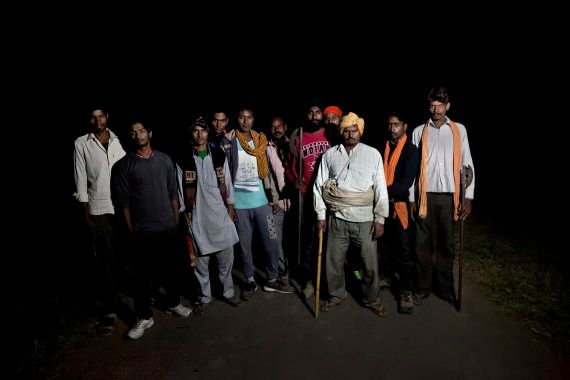 Members of a cow vigilante group pose for a photograph out on a patrol in the hopes of stopping vehicles...