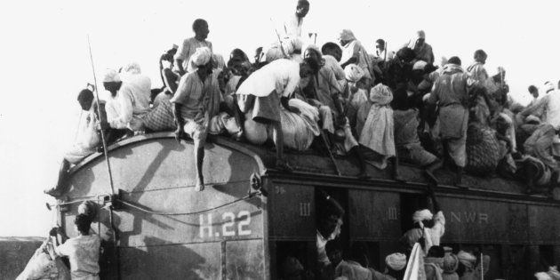 Muslim refugees cram into coaches and the roof of a train bound for Pakistan from New Delhi, India, on...