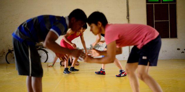 A training session at Balali akhara features both boys and girls. Wrestler sisters Babita and Sangita...