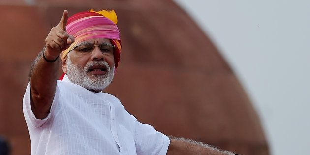 Indian Prime Minister Narendra Modi gestures as he delivers his Independence Day speech from The Red...