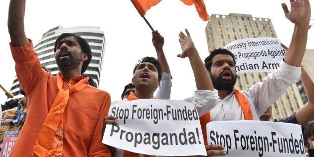 Activists from ABVP shout slogans during a protest against Amnesty International in New