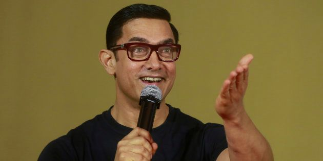 Bollywood actor Aamir Khan speaks to the media during the poster launch of his film 'Dangal' in Mumbai,