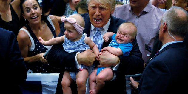 QUALITY REPEAT - Republican presidential nominee Donald Trump holds babies at a campaign rally in Colorado...