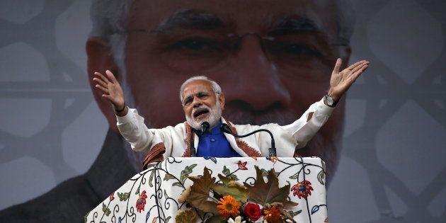 India's Prime Minister Narendra Modi addresses a rally in a cricket stadium in Srinagar, on 7 November,