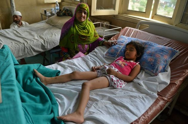 Five year-old Zohra Zahoor, who has pellet wounds in her legs, forehead and abdomen, sleeps on a hospital...