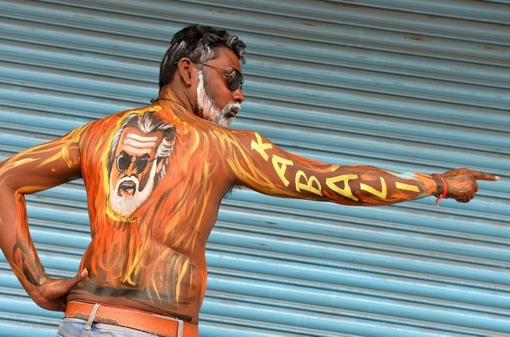 A fan of Indian Rajinikanth displays body paint with a portrait of the actor on the first day of release of 'Kabali' in Bangalore on July 22, 2016. (MANJUNATH KIRAN/AFP/Getty Images)