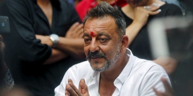 Bollywood actor Sanjay Dutt speaks with the media in the premises of his residence after he was released...