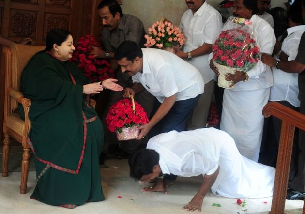 A party cadre prostrates himself at the feet of All India Anna Dravida Munnetra Kazhagam(AIADMK) leader...