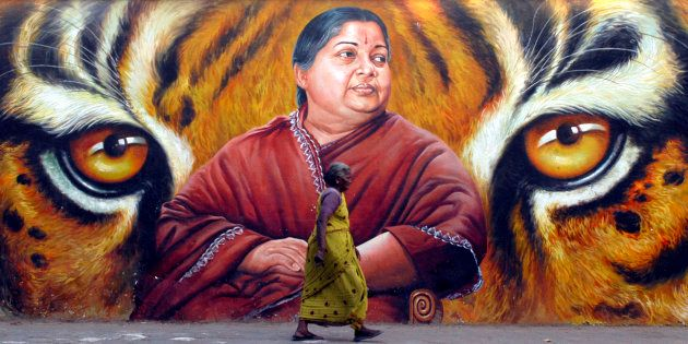 A woman walks in front of a portrait of Jayalalithaa in Chennai in 2009. REUTERS/Babu