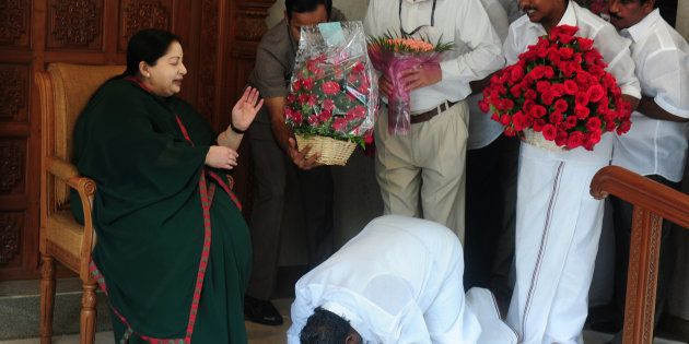 A party cadre prostrates himself at the feet of AIADMK leader Jayalalithaa in Chennai in May 2016.ARUN...