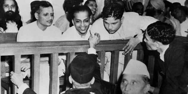 Some of the accused talk to their defense counsels before their trail for the assassination of Mahatma...