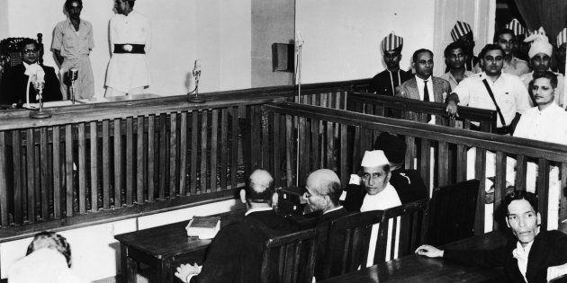 Nathuram Vinayak Godse, bottom right, on trial for the assassination of Mahatma Gandhi in the red fort,...