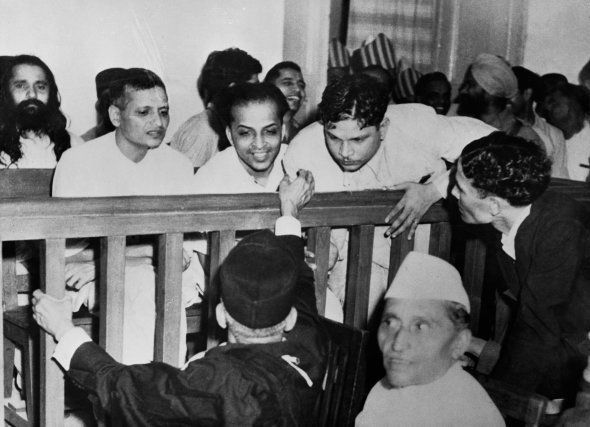 Some of the accused talk to their defense attorneys before their trial for the assassination of Mahatma