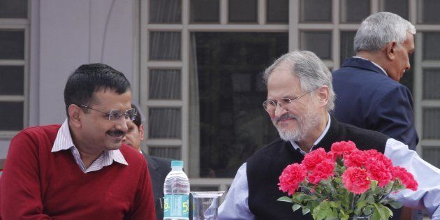 Lt. Governor of Delhi Najeeb Jung and Delhi Chief Minister Arvind Kejriwal felicitating and honoring...