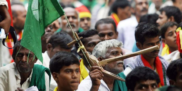 New Delhi, INDIA: Farmers and activists from the South Indian state of Karnataka participate in a demonstration...
