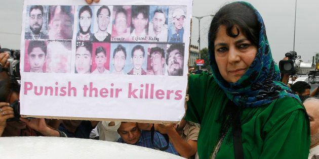 Mehbooba Mufti, chief of People's Democratic Party (PDP) Kashmir's main opposition party, shows pictures...