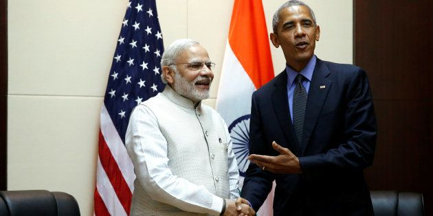 U.S. President Barack Obama stands for a handshake with India's Prime Minister Narendra Modi before their...
