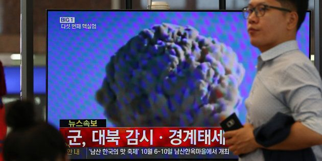 A man walks past a television screen showing a news broadcast on North Korea's nuclear test at Gimhae...