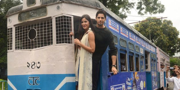 Bollywood actors Sidharth Malhotra and Katrina Kaif take a tram ride during the promotion of upcoming...