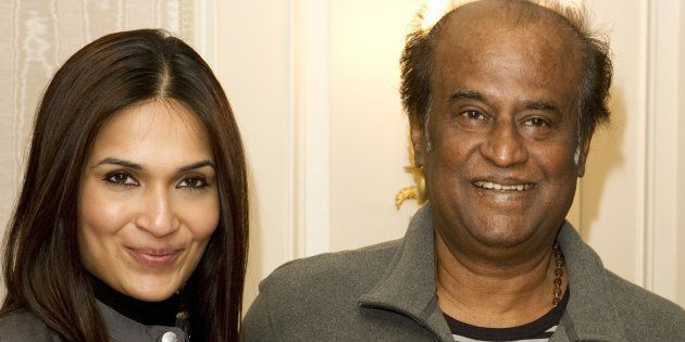 Bollywood director Soundarya and actor Rajinikanth pose in London during the promotion of the film