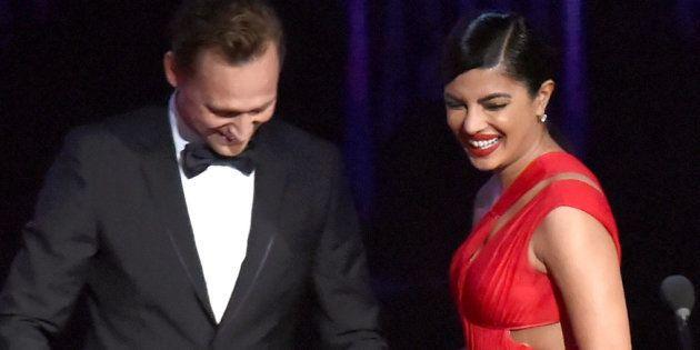 Tom Hiddleston and Priyanka Chopra speak onstage during the 68th Annual Primetime Emmy Awards at Microsoft...