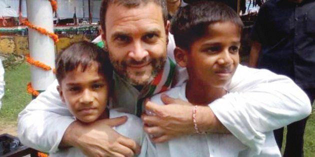Congress Vice President Rahul Gandhi with children at Acharya Narendra Dev Park during his Kisan Yatra...