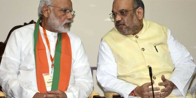 Prime Minister Narendra Modi, with National President of the Bharatiya Janata Party Amit Shah during...