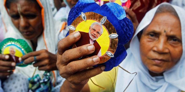 """Widows, who have been abandoned by their families, show """"Rakhis"""" or sacred threads with a picture..."""