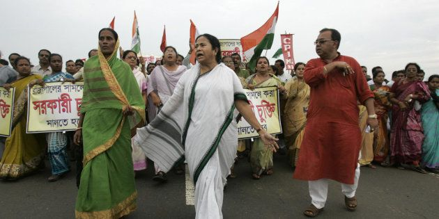 File photo of leader of India's Trinamool Congress (TMC) party Mamata Banerjee (C) marching beside the...