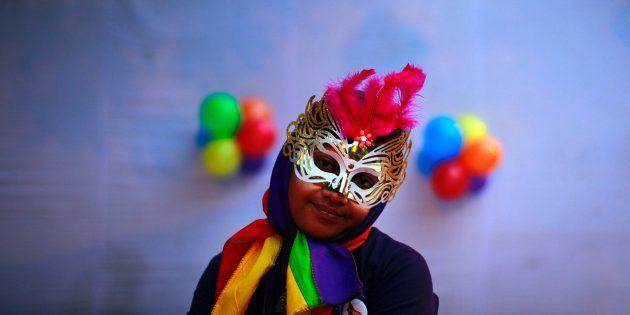 A participant attends the fourth Delhi Queer Pride parade