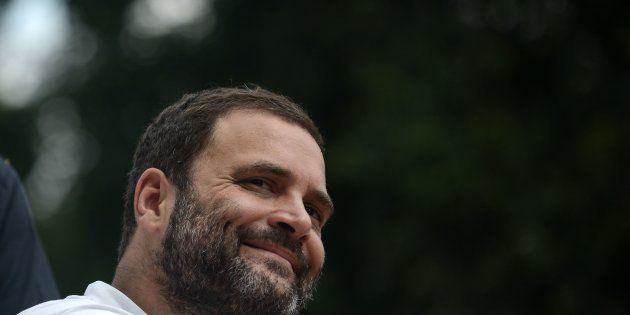 Congress vice president Rahul Gandhi smiles during a roadshow in Allahabad on September 15,