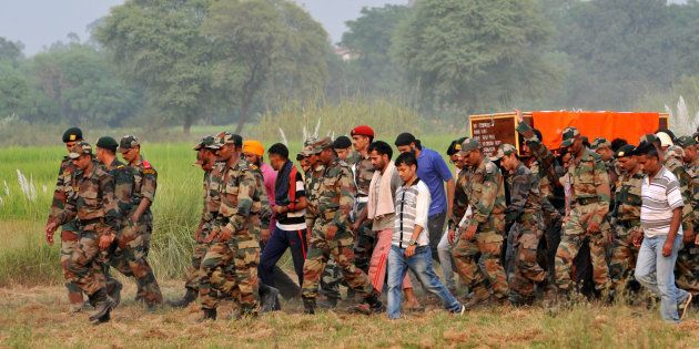 JAMMU, INDIA - SEPTEMBER 19: Army soldiers carry the coffin of martyr Ravi Paul for his last rites with...